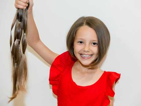Aria Barnes shows off her chopped locks, and her new-hairdo.