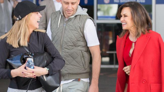 Lisa Wilkinson and Carrie Bickmore laugh as they arrive in Melbourne.