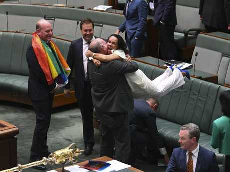 Look away now, Mr and Mrs Jensen. Liberal MP Warren Entsch celebrates with Labor MP Linda Burney. Picture: Lukas Coch/AAP