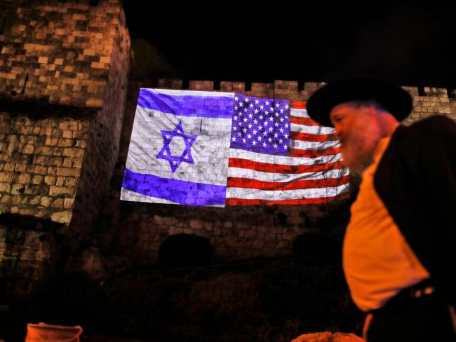 A giant US flag screened alongside Israel's national flag by the Jerusalem municipality on the walls of the old city. Picture: AFP/Ahmad Gharabli