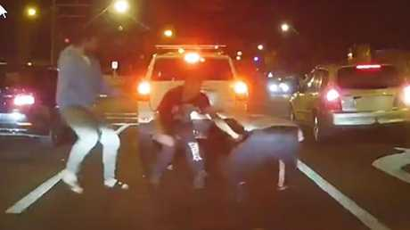 Dashcam footage appears to show a group of men fighting at the intersection of Tapleys Hill Road and West Lakes Boulevard. Source: Dashcam Owners Australia