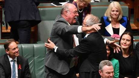 Liberal Member for Leichhardt Warren Entsch shares the moment with Mr Turnbull.