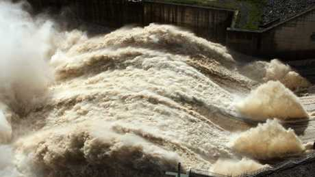 A raging torrent of water being released from Wivenhoe Dam into the Brisbane River.