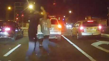 A group of men has been recorded in amateur video appearing to fight at the intersection of Tapleys Hill Road and West Lakes Boulevard. Source: Dashcam Owners Australia