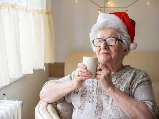 CHRISTMAS CARING: Lending a hand to elderly people brings the Christmas spirit alive.