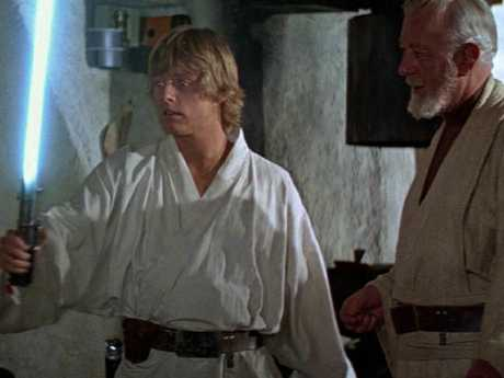 The young Luke Skywalker is introduced to a lightsabre by Jedi knight Obi-Wan Kenobi in Star Wars: A New Hope.
