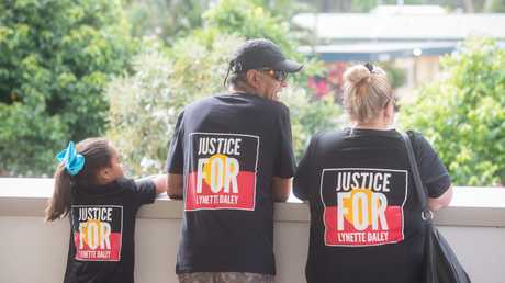 Family members of Lynette Daley wear shirts with