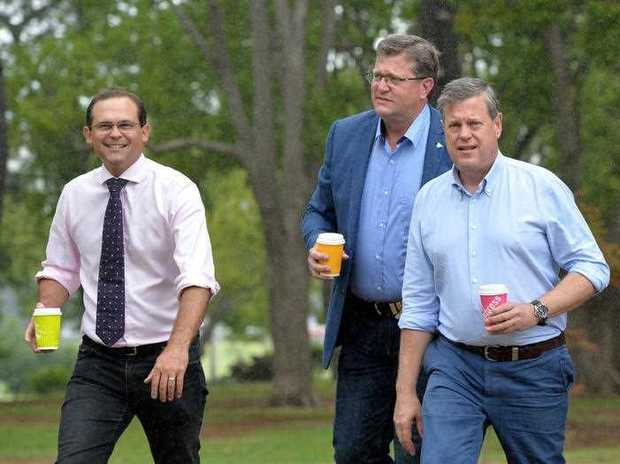 Opposition Leader Tim Nicholls speaks with LNP elected members Trevor Watts member for Toowoomba North and David Janetzki for Toowoomba South as they go for a walk in the park in Toowoomba Wednesday