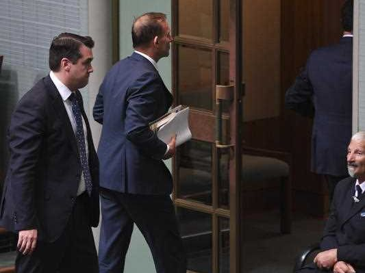 Former Australian prime minister Tony Abbott leaves the chamber ahead of the final vote on the Marriage Amendment Bill in the House of Representatives at Parliament House in Canberra Thursday