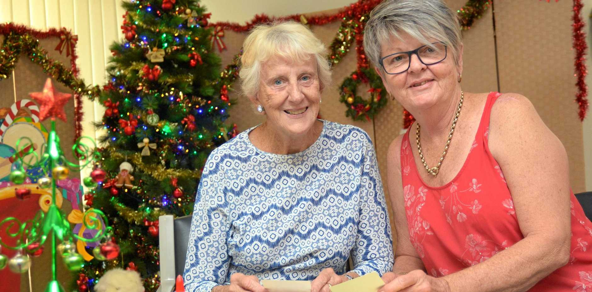 SHARING AND CARING: Client Pat Pritchard and volunteer Robyn Hollis, take advantage of craft activities to make Christmas gifts.