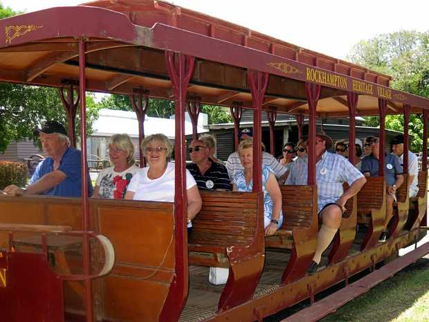 ALL ABOARD: Burleigh Waters Probus club members ride a tram at Rockhampton Heritage Village.