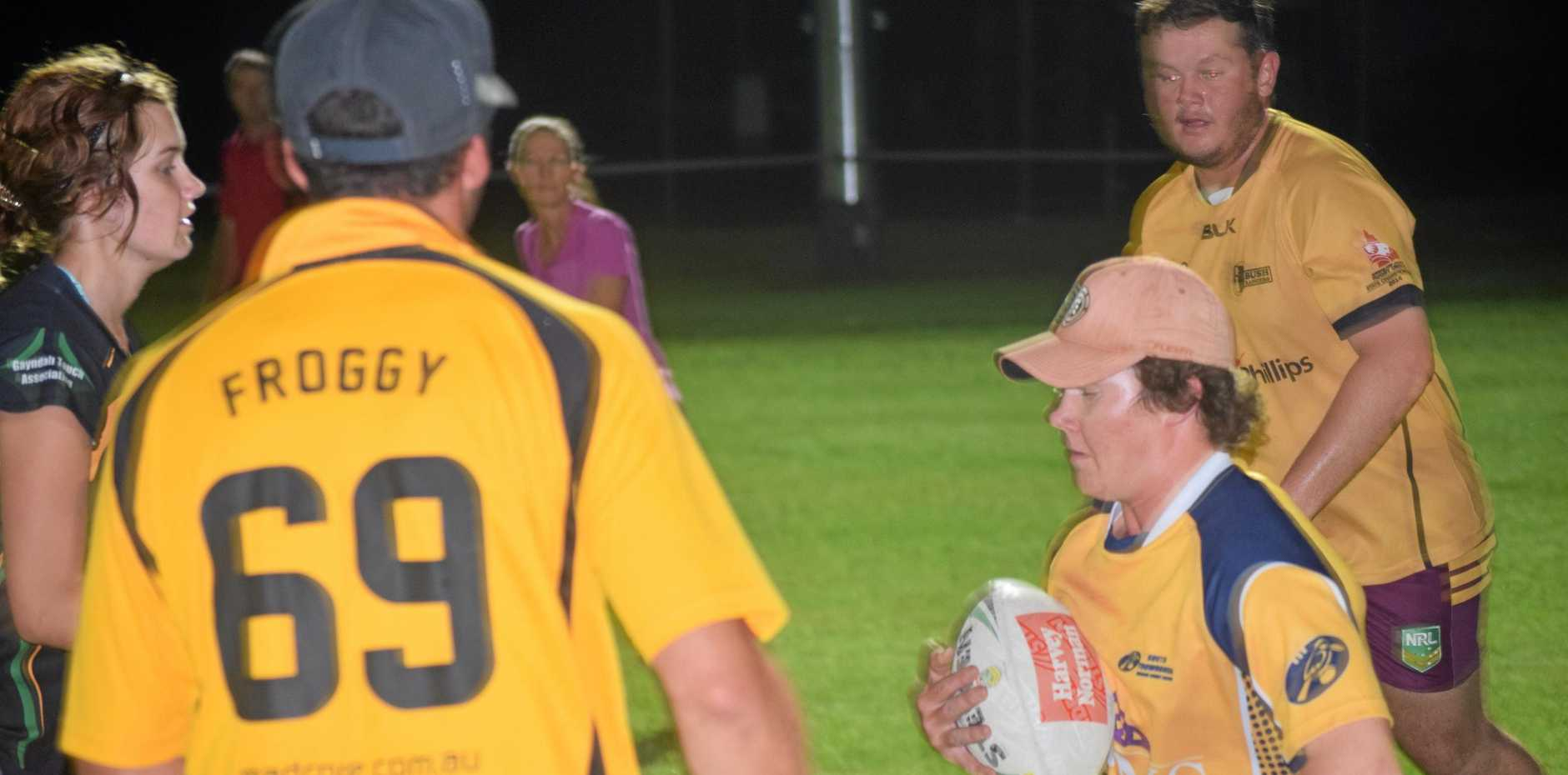 DODGING: Blake Crofts tries to get away from a defender in Monday night's grand final showdown in Mundubbera.