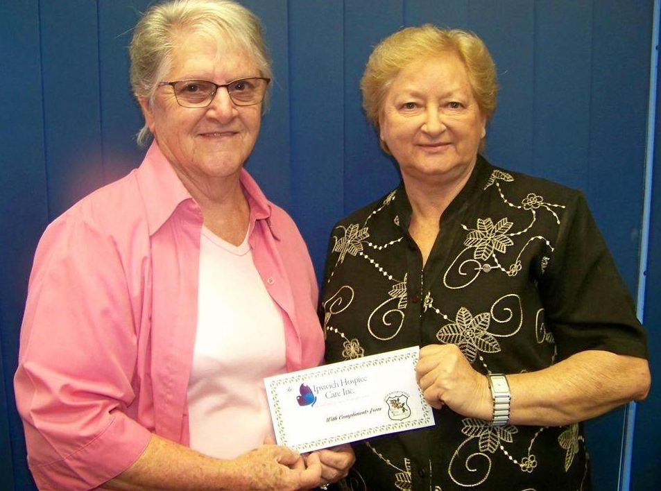 Ipswich Rugby League Old Boys Association president/secretary Jan Christison presents Denise Hanly with a $500 donation for Ipswich Hospice Care.