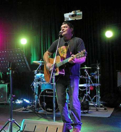CONVICTED RAPIST: Barry Roy on stage in Bundaberg.