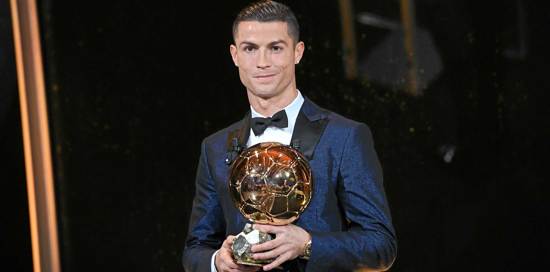 Real Madrid's Portuguese striker Cristiano Ronaldo with his record-equalling fifth Ballon d'Or award