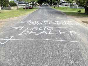 'Murderer, child abuser, drug dealer' sprayed on street