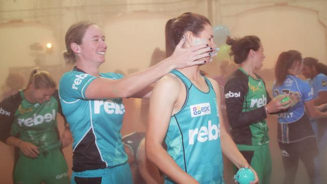 Beth Mooney of the Brisbane Heat wipes chalk on the face of Courtney Hill during the 2017-18 WBBL Women's Big Bash League season launch.