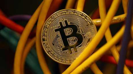 "Few people outside financial experts fully understand the invented the ""cryptocurrency"" Bitcoin but there are plenty of punters piling on board. Picture: Dan Kitwood/Getty"