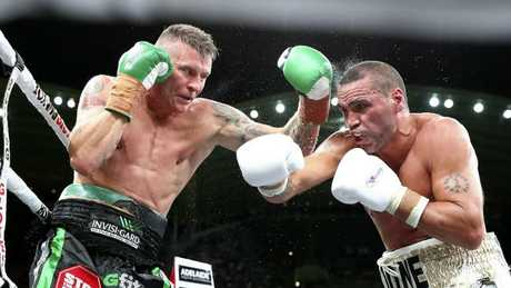 Anthony Mundine (R) lost a controversial decision to long-time rival Danny Green. Picture: Sarah Reed