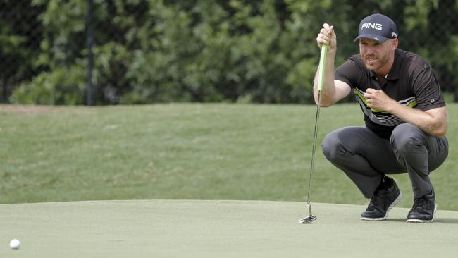SOLID SEASON: Adam Bland in action during the Australian PGA at RACV Royal Pines Resort on the Gold Coast. (AAP Image)