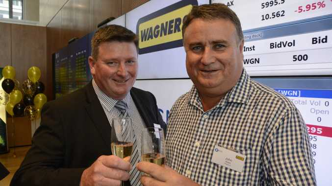 HAPPY DAYS: Wagners CEO Cameron Coleman and construction materials general manager John Stark, who are both long-term employees at the company, celebrate the successful float of the business on the ASX in Sydney.