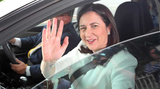 Queensland Premier Annastacia Palaszczuk waves as she arrives to Government House in Brisbane, Friday, December 8, 2017. Queensland Premier Annastacia Palaszczuk will formally declare victory in the state election after opposition leader Tim Nicholls conceded defeat. (AAP Image/Jono Searle) NO ARCHIVING