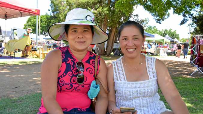 BIG DAY OUT: Van Nguyen (left) and Anh Nguyet found some shade from the hot sun at the Uber Markets in Warwick today.