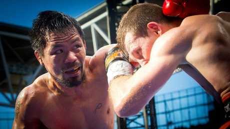 Manny Pacquiao (L) of the Philippines fighting Jeff Horn in November. Picture: AAP