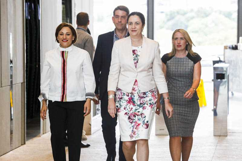 Queensland Premier Anna Palaszczuk (2nd right) with her new economic team, Jackie Trad (left), Cameron Dick and Kate Jones (right) in Brisbane, Sunday, December 10, 2017. Queensland Premier Annastacia Palaszczuk has given the treasury portfolio to her deputy Jackie Trad in a reshuffle of cabinet following the election.