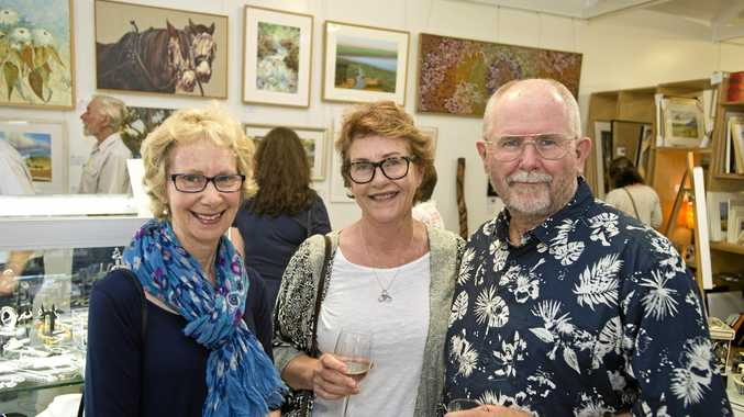 Checking out the artworks at MET Galleries are (from left) Robyn Croad, Jill Griffiths and Bruce Griffiths .