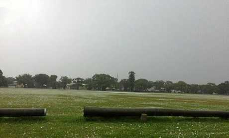 Play was abandoned in second grade action at JJ Lawrence Field after a hail storm covered the ground.