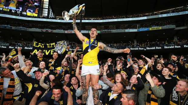 Dustin Martin celebrates with the premiership cup. Picture. Phil Hillyard