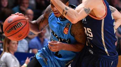 Edgar Sosa of the New Zealand Breakers and Nathan Sobey of the Adelaide 36ers.