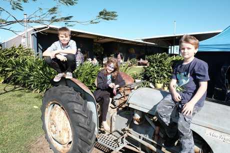 Zander Hope, Maddison and James Warwick at the Whitsunday Gold Coffee Farmer's Markets on Sunday morning. Photo Matthew Newton / The Guardian
