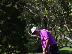 Professional golfer Mike Harwood putting on the final