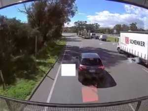 WATCH: Car cuts in front of truck