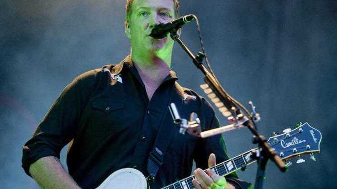 Singer and guitarist Josh Homme performs during the concert of the US rock band Queens of the Stone Age at the 22nd Sziget (Island) Festival on the Shipyard Island in Northern Budapest, Hungary, Tuesday, Aug. 12, 2014.