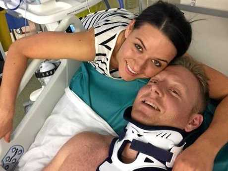 Former Gympie man Scott Hoare in a neck brace not long after his accident last December. Angie by his side as always.