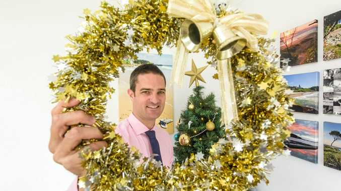 FESTIVE: Ray White Yamba co-principal Daniel Kelly promotes their Little Ray of Giving Christmas appeal.