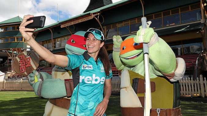 SYDNEY, AUSTRALIA - DECEMBER 10:  Courtney Hill of the Heat poses with Nickelodeon Teenage Mutant Ninja Turtles during the Women's Big Bash League WBBL match between the Perth Scorchers and the Brisbane Heat at North Sydney Oval on December 10, 2017 in Sydney, Australia.  (Photo by Mark Metcalfe/Getty Images)