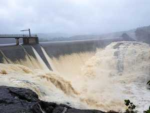 Coast dams run over as heavy rain fills past the brim