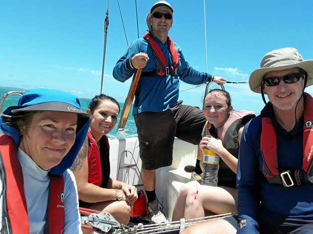 RESCUE EFFORT: Bonnita O'Driscoll, Peter Tibbs and Michael Newman with Cody and Shanay returning to harbour after the rescue