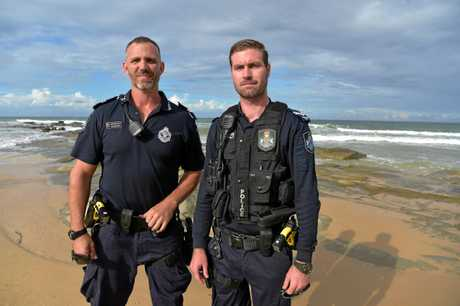 Senior Constable Ben Brewster and Senior Constable Ryan Woods return to the Mooloolaba beach where a man was saved.