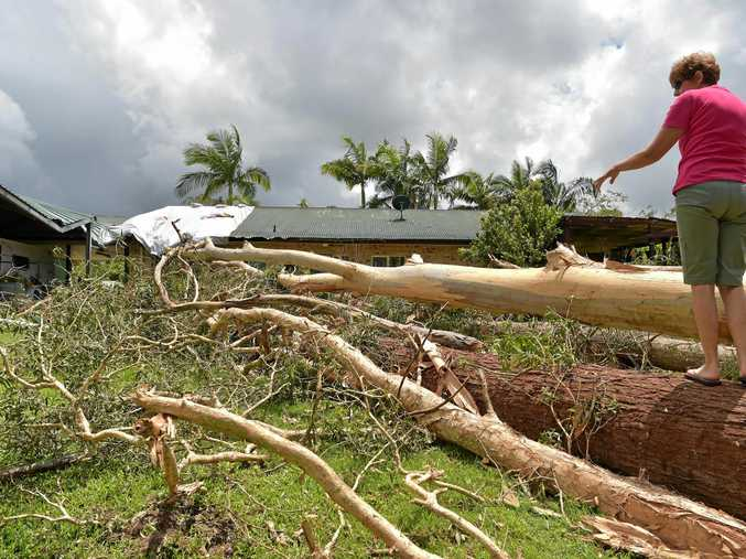 Residents of Sydney Dr, Beerwah clean up after a massive storm hit the area.