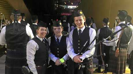 Past Drum Sergeant and SCOTS PGC College teacher Grace Peterson (Tenor drummer), SCOTS PGC College piper Abby Dalziel (Year 10) and SCOTS PGC College pipe major Jordan Simmers (Year 12) waiting to perform with Sir Paul McCartney in Brisbane last weekend.