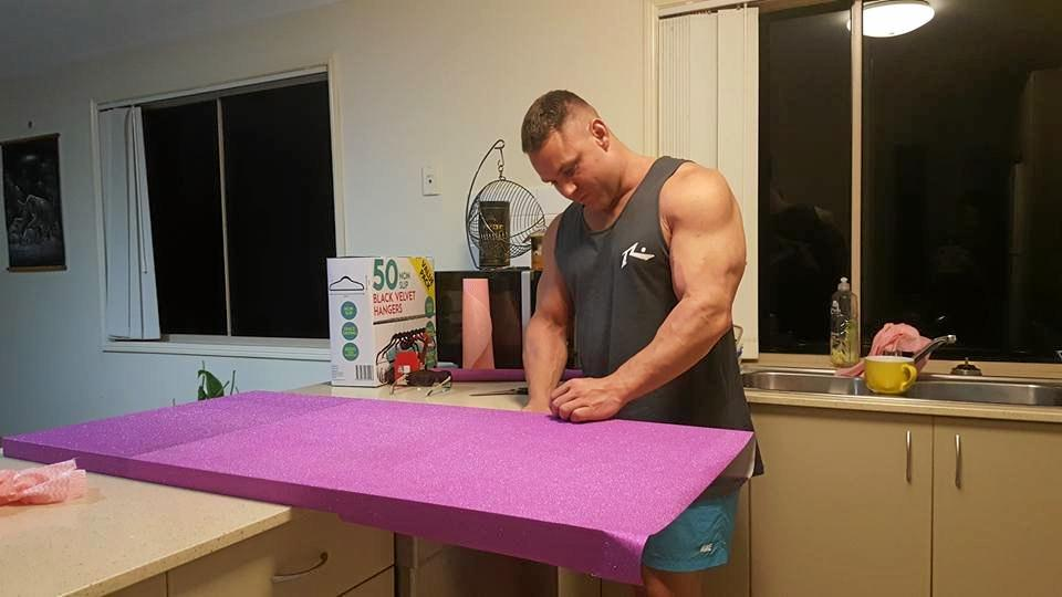 Mackay's Laura Ryan was overwhelmed with comments from her post about a make-up table on Kmart Mums Australia, with mums across the nation fawning over her partner Lloyd Westwood snapped mid-DIY project.