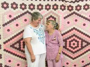 SURPRISE WIN: First winner of the Wilga Bolton award Dianne Lyons in front of her winning quilt at Maclean Patchwork and Quilters with foundation member Wilga Bolton.