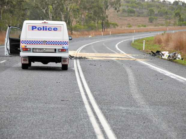 CRASH SCENE: Two Chinese tourists were killed from a pipe falling off the back of a truck near Raglan on the Bruce Highway on December 6, 2014.