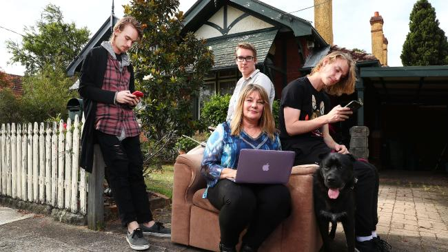 Yvonne Wallbank with her sons Max, Alex and Nic and dog Phoenix at their house in Cremorne, Sydney. She's not happy with her NBN connection. Picture: John Feder/The Australian
