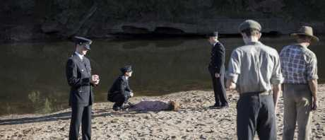 The creek becomes a crime scene as a body washes up. The victim? Regina Standish, played by Jenni Baird